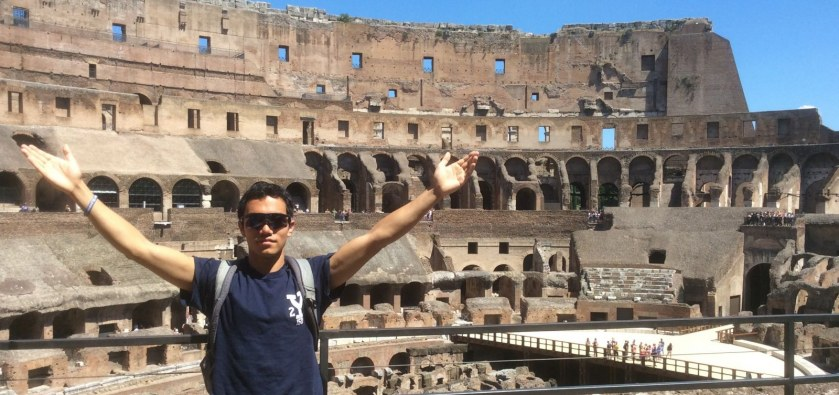 A Yale Student stands in front of the Colosseum in Rome