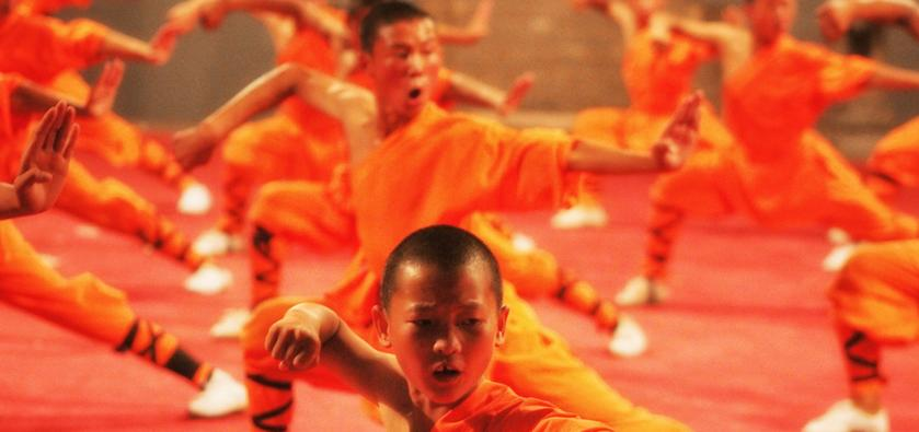 A group practicing martial arts at the Shaolin temple in China