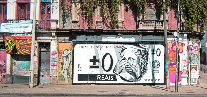 The image of a weeping Brazilian real, painted on a street corner in Rio