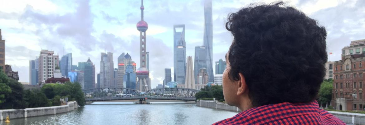 Student observing the Oriental Pearl Tower in Shanghai, China