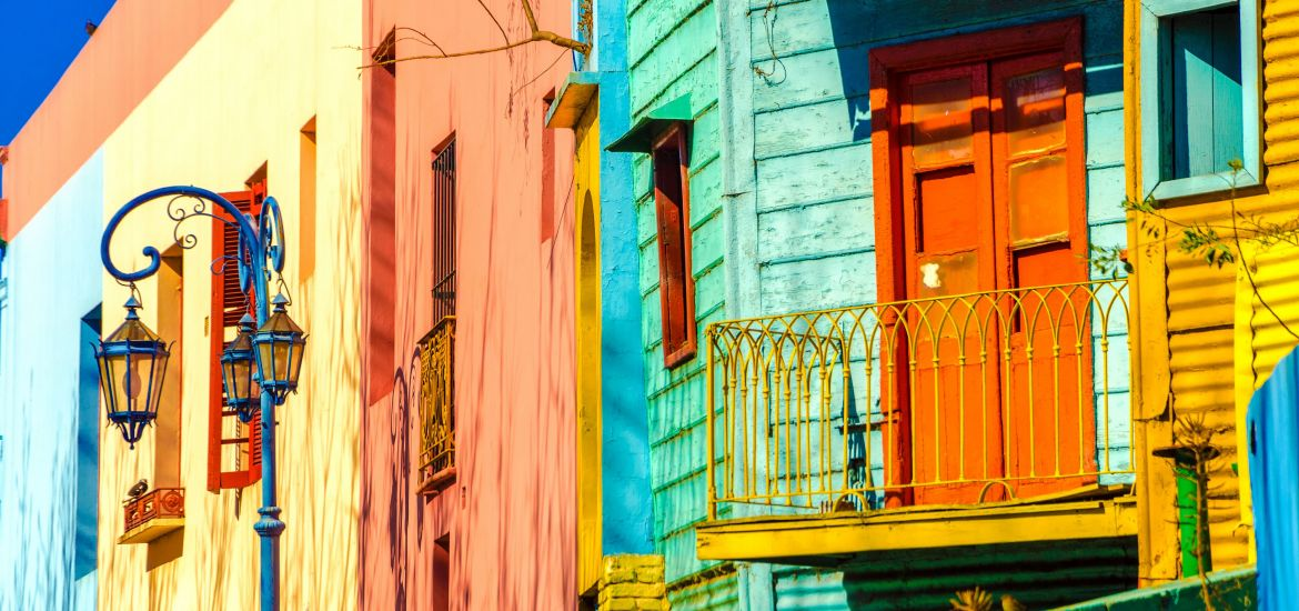 Residential buildings painted blue, yellow, orange and green in Buenos Aires, Argentina