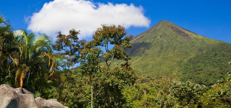 Green hillsides that surround Arenal Volcano