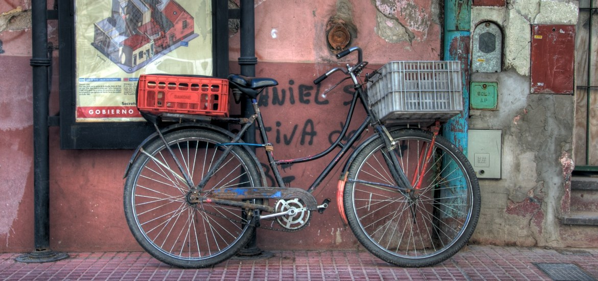 A bicycle leaning against a wall in Buenos Aires, Argentina