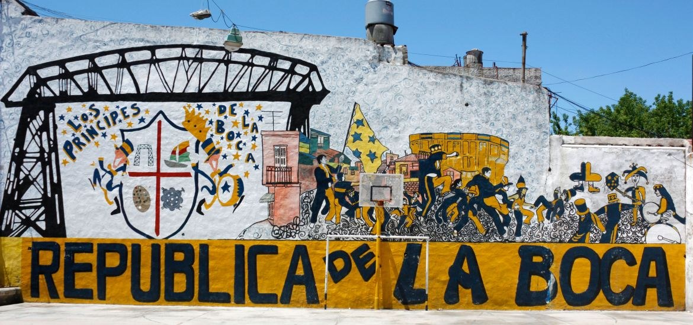 A colorful murial depicting La República de La Boca