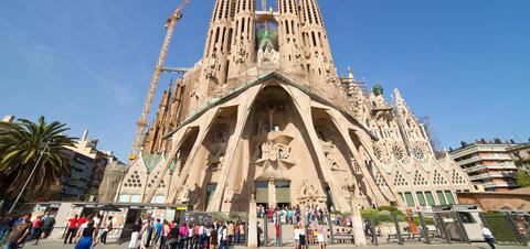 Tourists visiting La Sagrada Familia in Barcelona