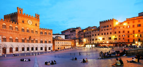 Locals enjoying early evening in Piazza del Campo.