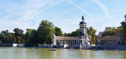 Boats on the pond at Bueno Retiro Park in Madrid, Spain