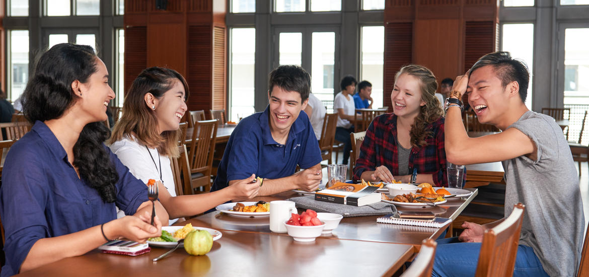 Students enjoying thier meal in a dining hall